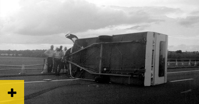 caravan accident - flipped on its side